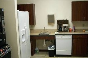Kitchen area with fridge and coffee