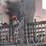 Firefighter putting out a fire on a building