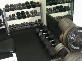 Fitness weights located in the Hughes Community Center weight room